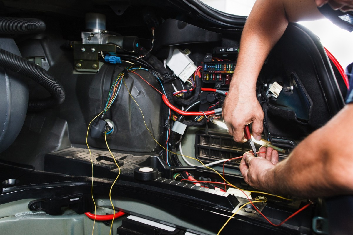 mechanic working on auto electrical system